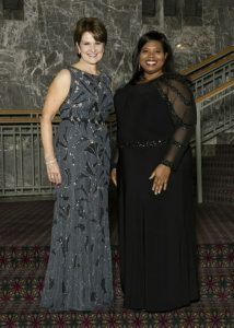 Tamara Crawford (right) ins congratulated by Marilyn Hewson, Lockheed Martin chairman/president/CEO.
