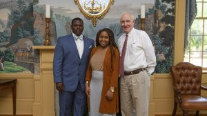 Derek and Kelly King stand with Andy Mullins in Lyceum at UM. Photo by Thomas Graning/Ole Miss Communications