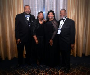 Tamara Crawford (second from right) surrounded by (from left) her brother, Kendrick Crawford; mother, Jeanelle Crawford; and father, Archie Crawford.