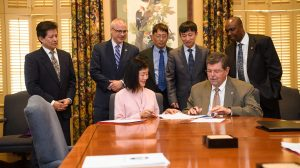 UM Provost Morris Stocks (seated, right) and NCUT Vice President Zhili Shen (seated, left) sign a partnership agreement between the two universities. Witnesses to the event include (standing, from left) Ge-Yao Liu, Director of UM Office of International Programs; Noel Wilkin, UM Senior Associate Provost; Alex Cheng, UM engineering dean; Jiaquan Xiong, director of NCUT's International Office; and Nosa Egiebor, UM executive director of global engagement. Photo by Robert Jordan/Ole Miss Communications