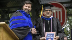 University of Mississippi Interim Vice Chancellor of Research and Sponsored Programs Josh Gladden presents Ikhlas A. Khan with the Distinguished Research and Creative Achievement Award during Commencement 2016. Photo by Thomas Graning/Ole Miss Communications