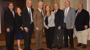 Members of the TPR Study Group with Gov. Phil Bryant. (L-R): Randy Pierce, Mississippi Judicial College (MJC) director; Patti Marshall, Miss. Attorney General's Office; Bill Charlton, MJC staff attorney; Gov. Phil Bryant; Carole Murphey, MJC staff attorney; David Calder, associate clinical professor at the University of Mississippi School of Law; Judge John Hudson, Jurist in Residence; and Judge Tom Broome, Rankin County Court judge. Photo by Beverly Kraft, PIO of the Mississippi Administrative Offices of the Court.