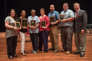 Seven UM staff members are recognized for outstanding service.