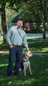 UM graduate student Ben Stepp and service dog Arliegh have attended every class together since 2014. Photo by Robert Jordan/Ole Miss Communications