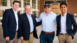 Will Stroud (in cap) is greeted at the Pavilion by, from left, Keith Carter, executive director of the Ole Miss Athletics Foundation, Wendell Weakley, president of the UM Foundation, and Matt Mossberg, associate athletics director for development and major gifts. Photo by Bill Dabney