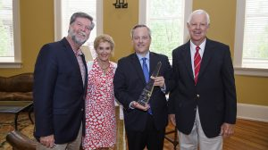 The Center for Innovation and Entrepreneurship and the School of Business Administration honor William Yates as the 2016 Distinguished Entrepreneur of the Year during a reception at the Farrington Gallery in Bryant Hall. Pictured are Dean Ken Cyree, Jan Farrington, Yates and Lawrence Farrington. Photo by Thomas Graning/Ole Miss Communications