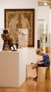 A museum visitor takes advantage of First Friday Free Sketch at the UM Museum. The next sketch opportunity is Friday, July 1. Photo by Robert Jordan/Ole Miss Communications