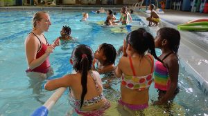 Children participate in a swimming lesson at the Turner Center Pool.