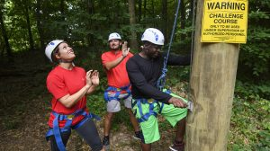 Members of the Mississippi Principal Corps 2016 cohort work through team-building exercises at he Rebel Challenge Course. Photo by Thomas Graning/Ole Miss Communications