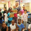"CELI literacy specialist Angie Caldwell reads ""An Ambush of Tigers"" to children at Willie Price University Lab School."