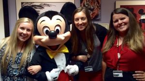 Heidi Bain with Mickey Mouse and two of her cowokers in the office.