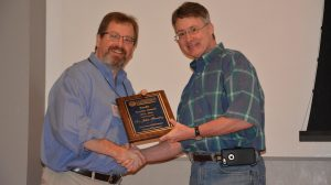 Dean David D. Allen (right) presents Bentley with the 2015 School of Pharmacy Faculty Service Award.