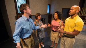 Daniel Schultz (left), Faith Janicki, Tysianna Jones and Jonathan Orange rehearse for a scene from the Ole Miss Theatre production of 'Clybourne Park,' opening Sept. 23 in Meek Hall Auditorium. Photo by Kevin Bain/Ole Miss Communications