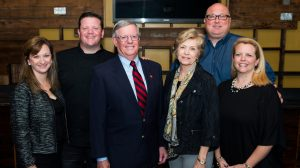 Don Jones and wife, Melissa M. Jones (center) stand with, from left, daughter-in-law Melissa G. Jones, son Dru Jones, son-in-law Kurt Autenreith and daughter Kelly Jones Autenreith at a surprise lunch held in Don Jones' honor earlier this year. Photo by Bill Dabney