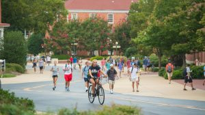 Students head to class at the University of Mississippi, which has experienced record enrollment again this year. Photo by Kevin Bain/Ole Miss Communications