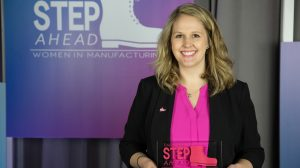 Six Sigma Black Belt Nichole Williams poses with her 2016 Emerging Leader Award. Photo courtesy of the National Assoc. of Manufacturers;Photo by Ian Wagreich