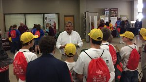 UM Field Station Director Scott Knight (center) shares with 8th grade students during the Career Expo. (Submitted photo by William Nicholas)