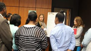 """UM student Alex Fratesi and Right! from the Start Director Sannie Snell facilitate a """"world cafe"""" discussion on factors associated with poor birth outcomes."""