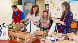 David H. Holben (left) and members of his project team prepare bags of food to be delivered to students at Bruce Elementary School. Helping are (from left) Sydney Antolini, Michelle Weber and Kelsey Reece, all nutrition graduate students at Ole Miss. Photo by Bill Dabney