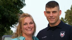 Lisa Langley Robertson, left, and her late husband, UPD Officer Robert Langley, right. Submitted photo.
