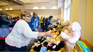 Jackie Certion helps distribute toys during 2015 Books and Bears event. Photo by Kevin Bain/Ole Miss Communications