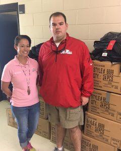 UM Kappa Alpha member and senior John Grantham delivers school supplies collected by the chapter to Tara Bullard, principal at West Lumberton Elementary School in Lumberton, North Carolina.
