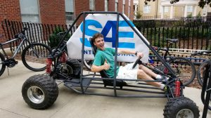 A young visitor to campus tests a SAE project on display. (Submitted photo)