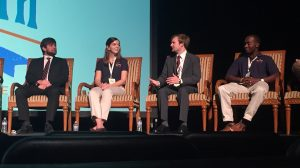 UM students Harleigh Huggins (second from left) and Joseph Reed (far right) answer questions following a presentation at the Southern Automotive Association annual meeting. (Submitted photo by Taylor Scism)