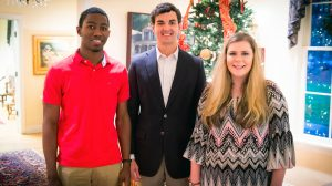 UM alumnus Jimmy Carr (center) greets his 2016 scholarship recipients, Pride of the South Marching Band members James Vinson (left) and Taylor Bost at Memory House. Photo by Bill Dabney