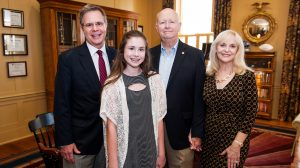 UM Chancellor Jeffrey Vitter, left, visits with Paige, Terry and Cindy Crawford to thank them for the Mitchell Crawford Eagle Scout Scholarship Endowment. The scholarship will assist business students with first preference going to Eagle Scouts. UM photo by Bill Dabney