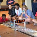 High school students start the final race with project cars they built during the UM Summer College for High School Students on the Oxford campus. The UM Pre-College Programs Department is offering certificates for parents, grandparents and relatives who want to the gift of a learning experience to a child or teen for summer 2017.