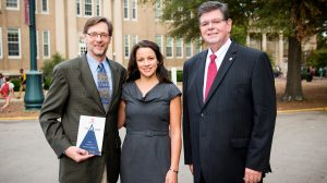 UM professor Ken Sufka (left) and his wife, Stevi Self, have established a scholarship from royalties received from the publication of Sufka's book. UM Provost Morris Stocks (right) was instrumental in making the book required reading for all entering students. Photo by Bill Dabney