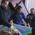 'Sorts-Giving' Volunteers Do Dirty, but Important, Work