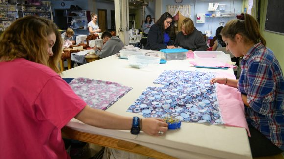 Theatre Students Make Dresses for Young Girls in Need