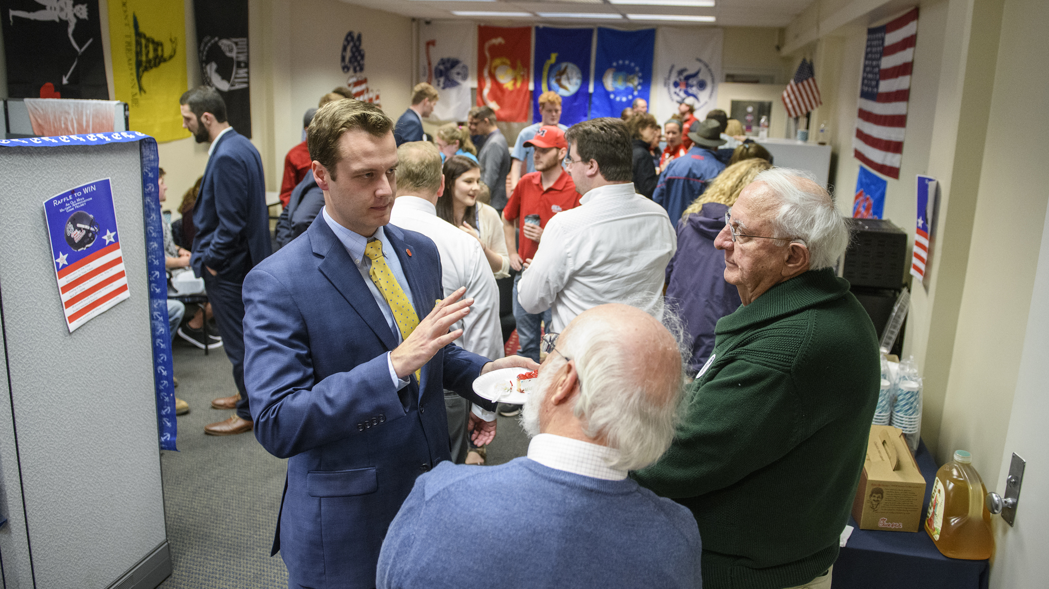 Andrew Newby (left), assistant director for Veteran and Military Services,  speaks with guests at the opening of the Veterans Resource Center.