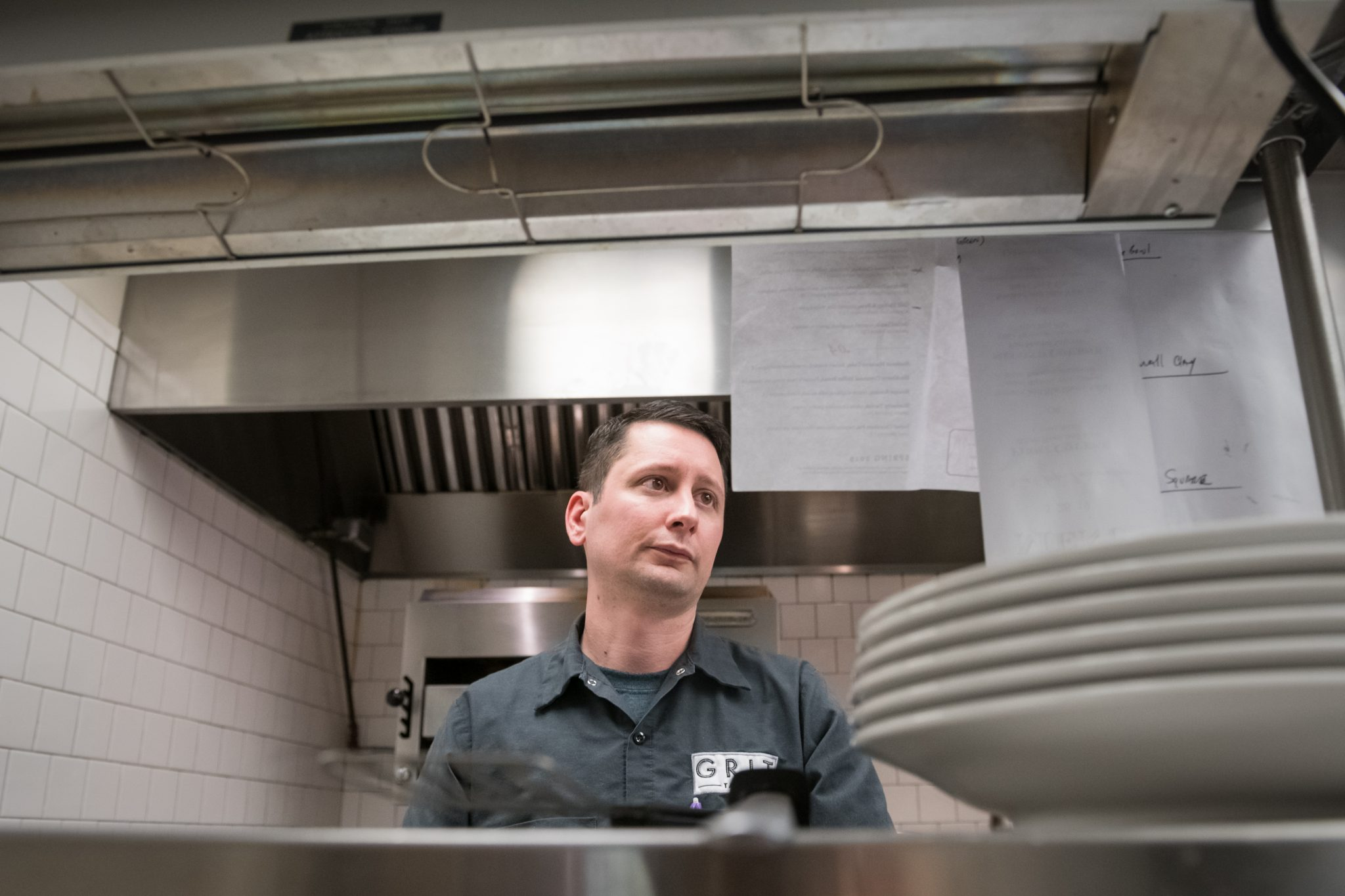 Eric Peters works the line at Grit restaurant in Taylor. The University of Mississippi student, who battled alcohol addiction during his career as an executive chef, has been sober for years and is working on his degree. Photo by Megan Wolfe/Ole Miss Digital Imaging Services