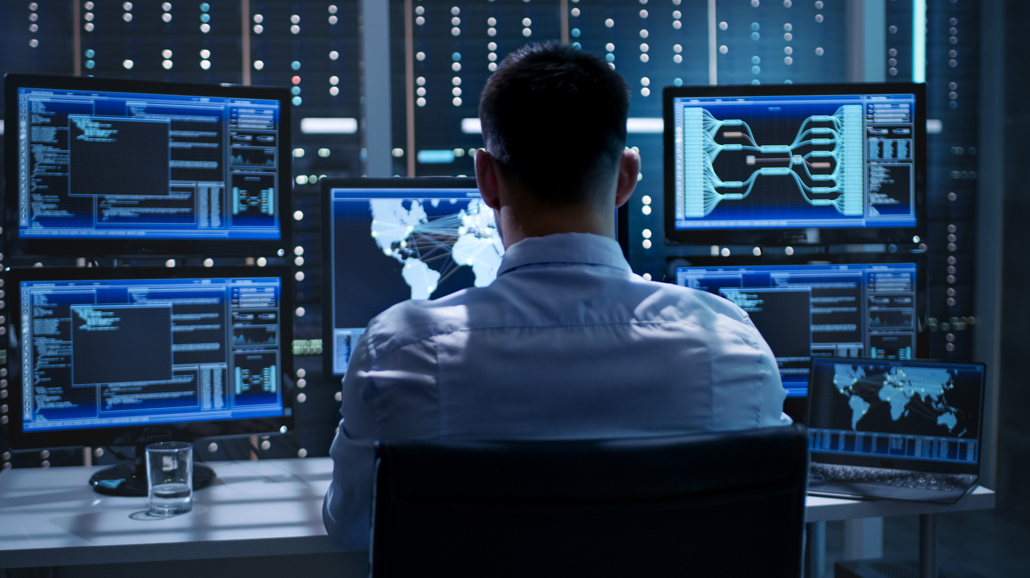 System Security Specialist Working at System Control Center. Room is Full  of Screens Displaying Various Information. - Ole Miss News
