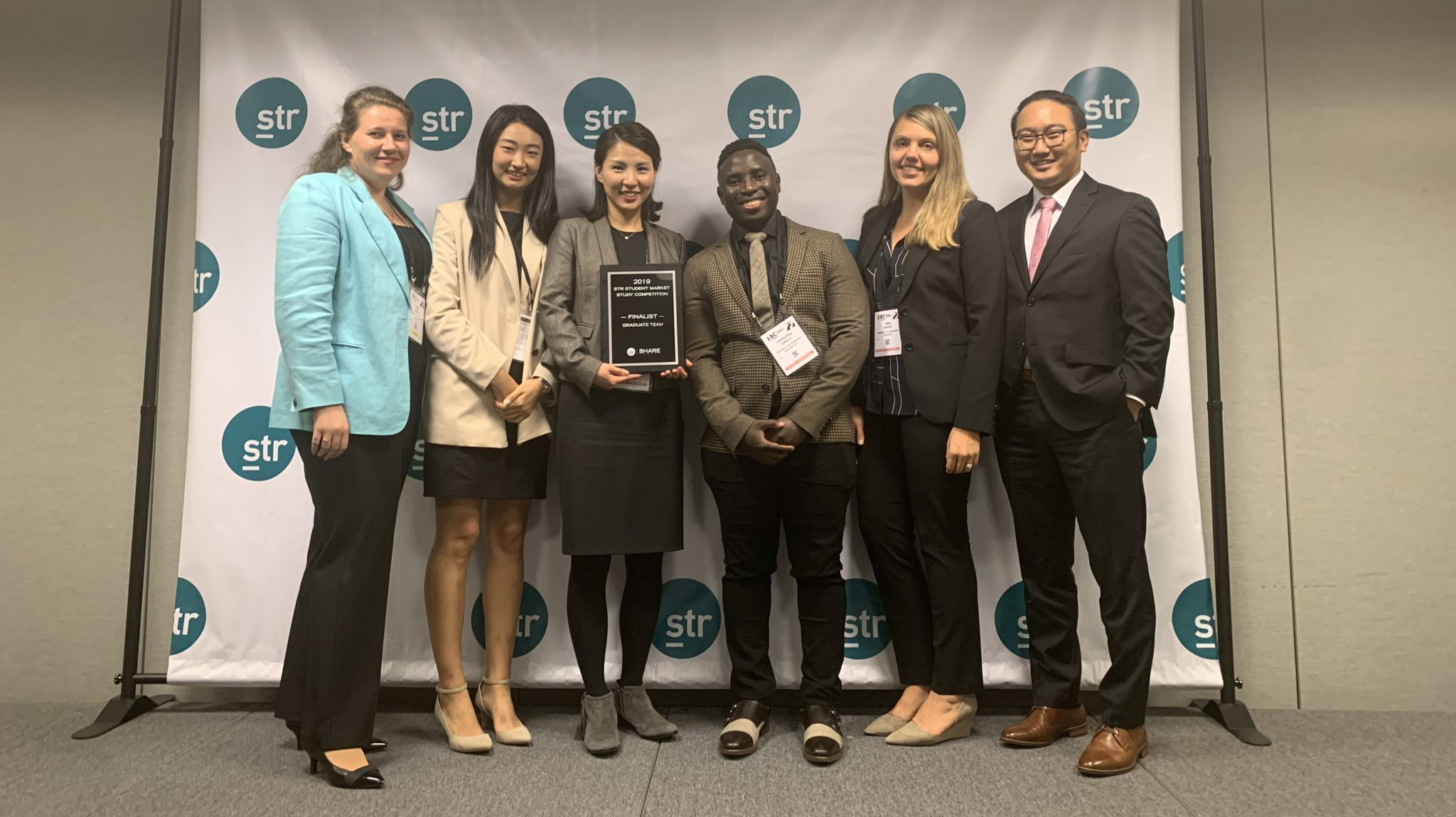 Cindy Choi, assistant professor of nutrition and hospitality management, congratulates hospitality management doctoral students (left to right) Olena Ciftci of Ukraine, Hayeon Choi of South Korea, Thamsie Jongile of South Africa, Inna Soifer of Russia, and Jangwoo Jo of South Korea for being recognized as finalists in the STR Student Market Study Competition in New York this November. Submitted photo