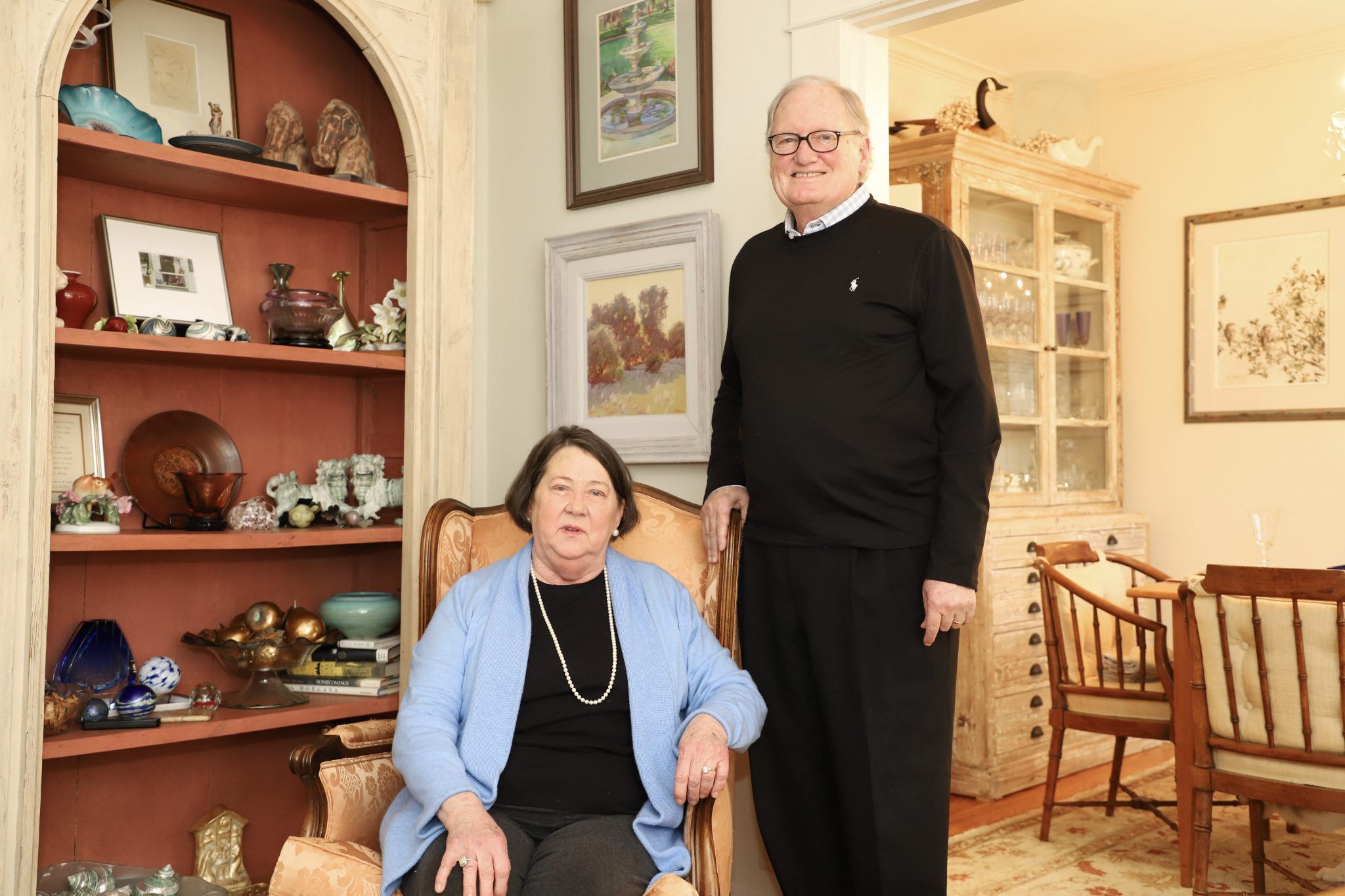 """Melody and John Maxey of Oxford, Mississippi, have given a prized watercolor by artist Dean Mitchell to the University of Mississippi Museum and Historic Houses. The piece, """"Signs of the Times, will be featured this month in the museum's pop-up space. The University Museum is open to the public 10 a.m. until 6 p.m., Tuesday through Saturday. Photo by Kirsten Faulkner/University of Mississippi"""
