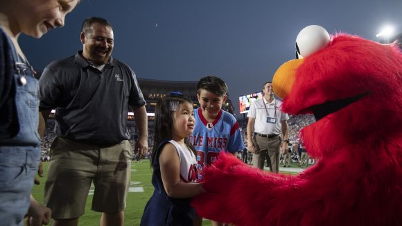 Everly and Elmo Take the Field